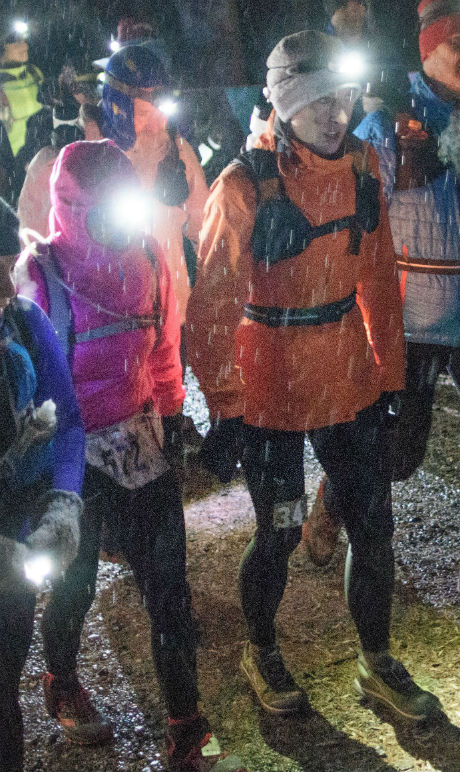In freezing rain, the start of the Devil Dog 100 - Stephanie Fonda in orange jacket, ^z following in white windbreaker - photo by David Potts