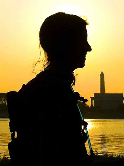 Kate Abbott on the Potomac River at sunrise in front of the Washington Monument and Lincoln Memorial