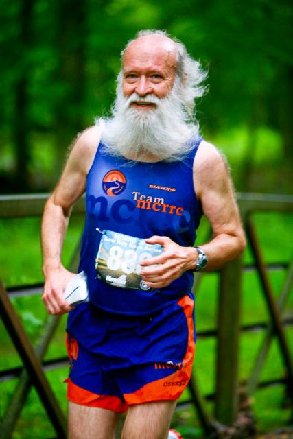 Just thrilled to be alive at Mile 3+ of the Montgomery County Road Runners Memorial Day 4 miler - photo by Dan Reichmann