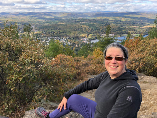 Dr Mary Ewell on Wantastiquet Mountain NH overlooking Brattleboro VT